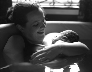 Image of Jenna in pool with her newborn